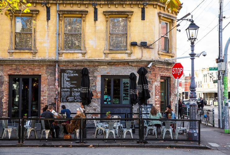 Diners outside of a pub on Brunswick Street in Fitzroy © Visit Victoria