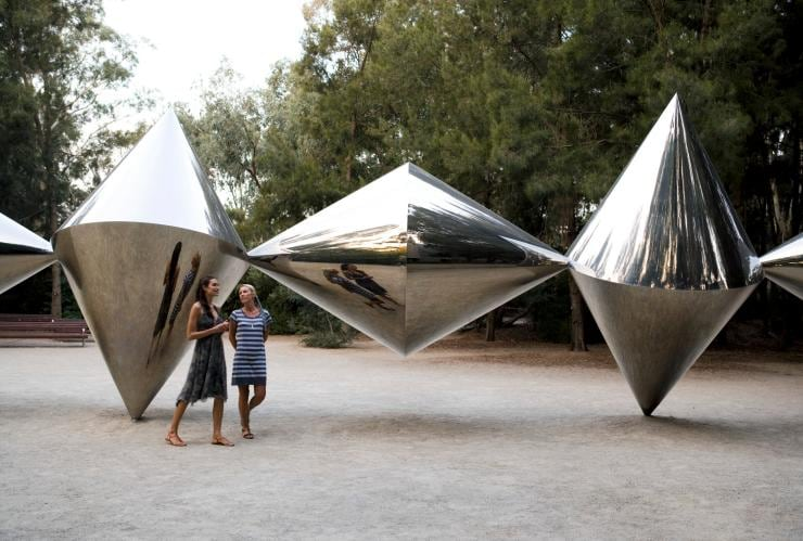 Visitors admire a Bert Flugelman sculpture at the National Gallery of Australia in Canberra © Tourism Australia