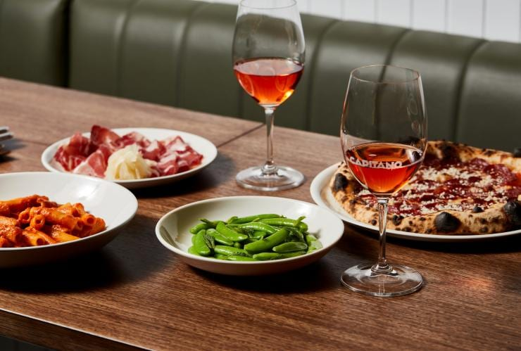 Food and wine on a table at Capitano in Melbourne © Capitano