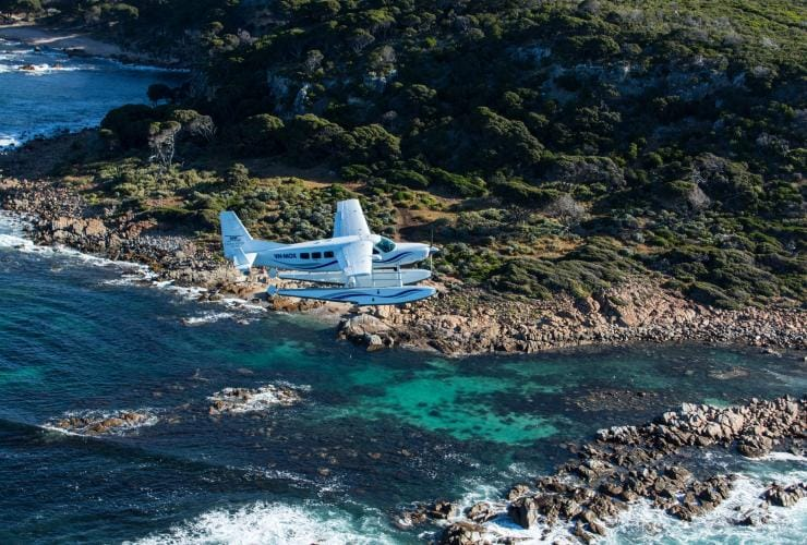 A Swan River Seaplane flies above the Margaret River coastline © Swan River Seaplanes