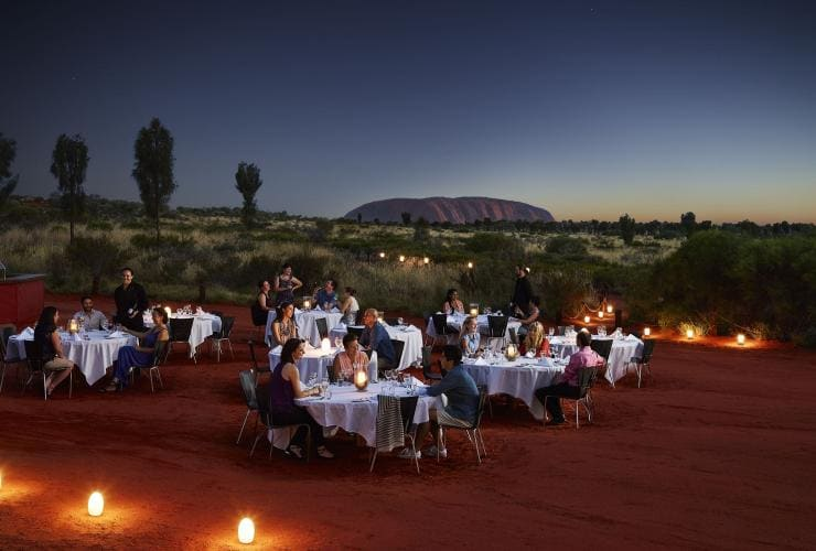 Diners at the Sounds of Silence dinner next to Uluru © Voyages
