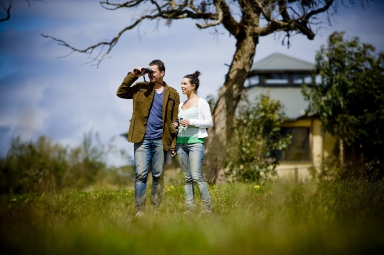 Couple outside The Great Ocean Ecolodge, Apollo Bay © Visit Victoria