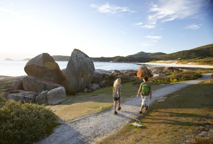 Couple hiking near the ocean in Wilsons Promontory National Park © Visit Victoria