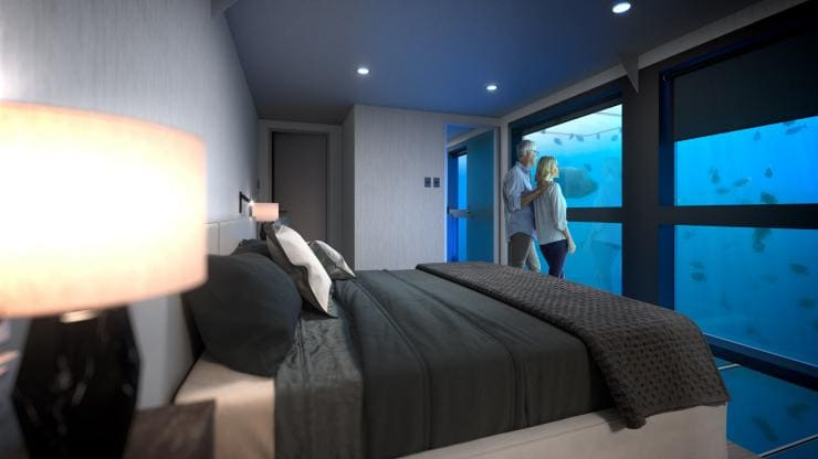 Couple in their underwater Reef Suite bedroom © Cruise Whitsundays