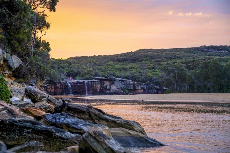 View of a waterfall at sunset in the Royal National Park © Tourism Australia