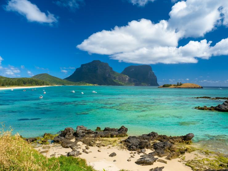 Beach on Lord Howe Island with Mount Gower and Mount Lidgbird in the background © Tourism Australia